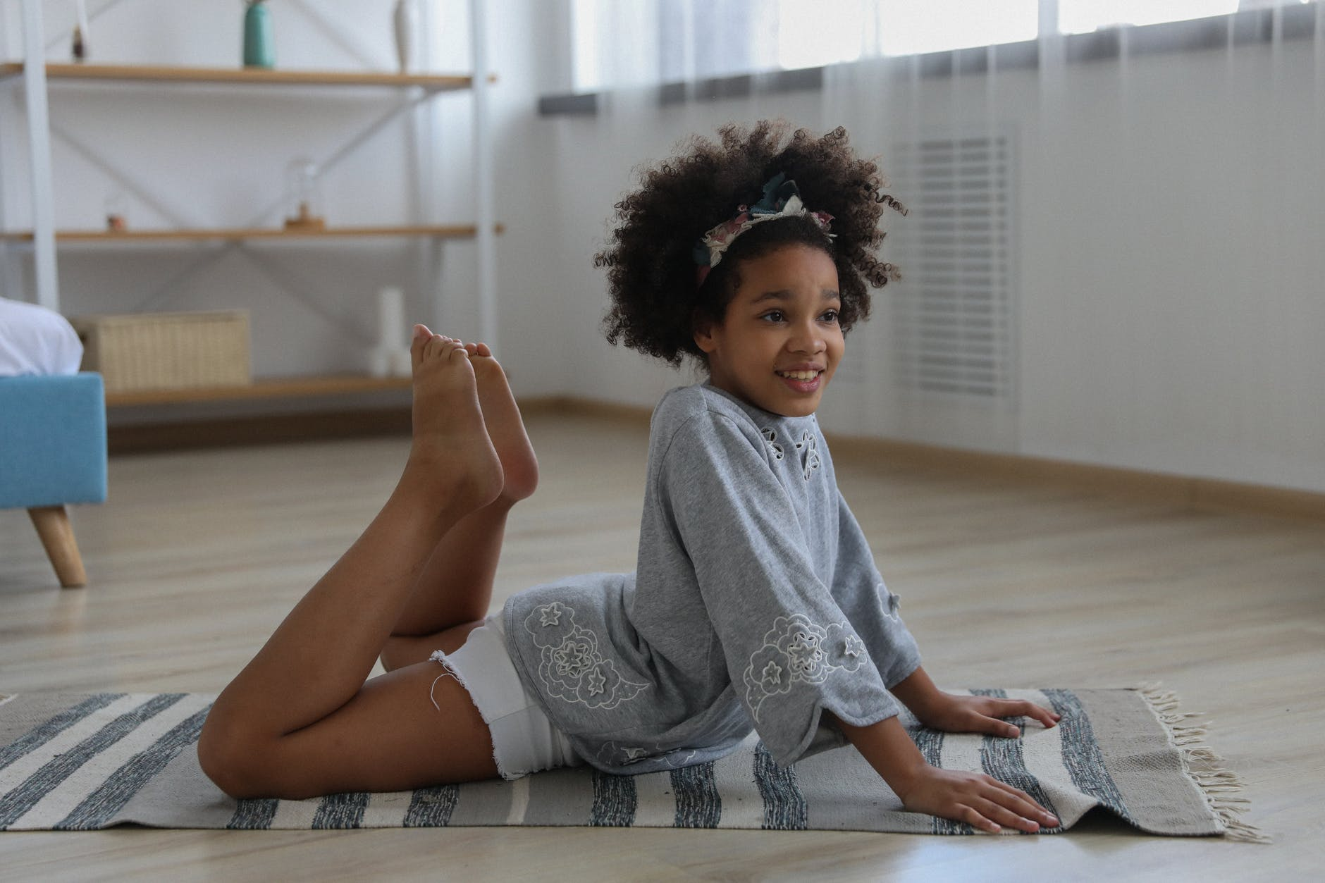 content ethnic girl doing yoga pose